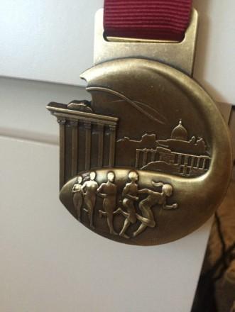 La sospirata medaglia della Maratona di Roma